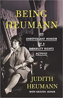 Being Heumann cover: a photo of a light-skinned woman sitting on a chair