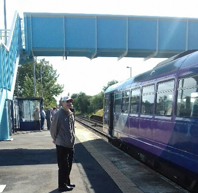 A train bound for Grimsby and Cleethorpes picking up passengers at Brigg railway station