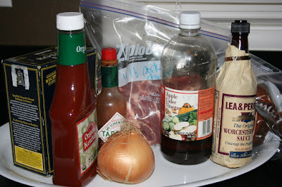 these are the ingredients to make a homemade from scratch barbecued pulled pork in the crockpot slow cooker. Recipe from ayearofslowcooking.com