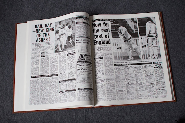 The cricket headline book open at a random page showing 2 pages from newspapers about England cricket matches