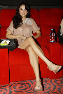 Mandana Karimi Sitting On Couch And Exposing Legs