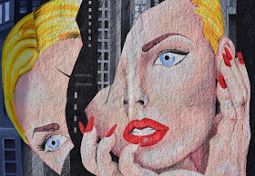 Pop art image of a blonde woman with her face cracked in half