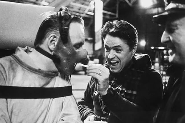 60 Iconic Behind-The-Scenes Pictures Of Actors That Underline The Difference Between Movies And Reality - Even Hannibal Lecter loves french fries.
