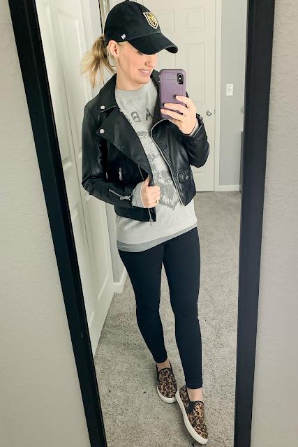 Sweatshirt layered with moto jacket