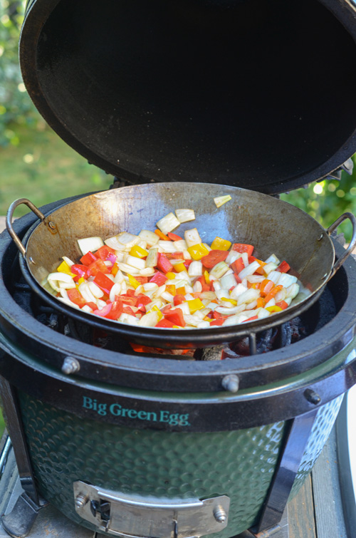Stir frying sweet and sour vegetables on the Big Green Egg Mini-Max kamado grill