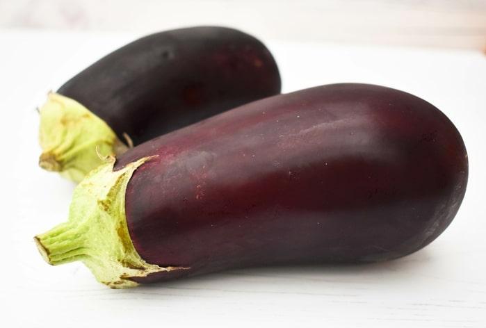 two aubergines (eggplants)
