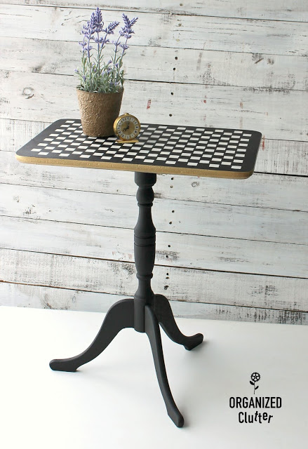 Photo of upcycled vintage flip top table with checks