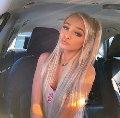 Zoe LaVerne talking a selfie inside her car