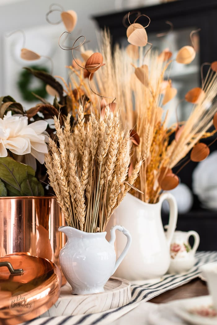 natural dried wheat, grasses and leaves in vintage ironstone pitchers and copper canister