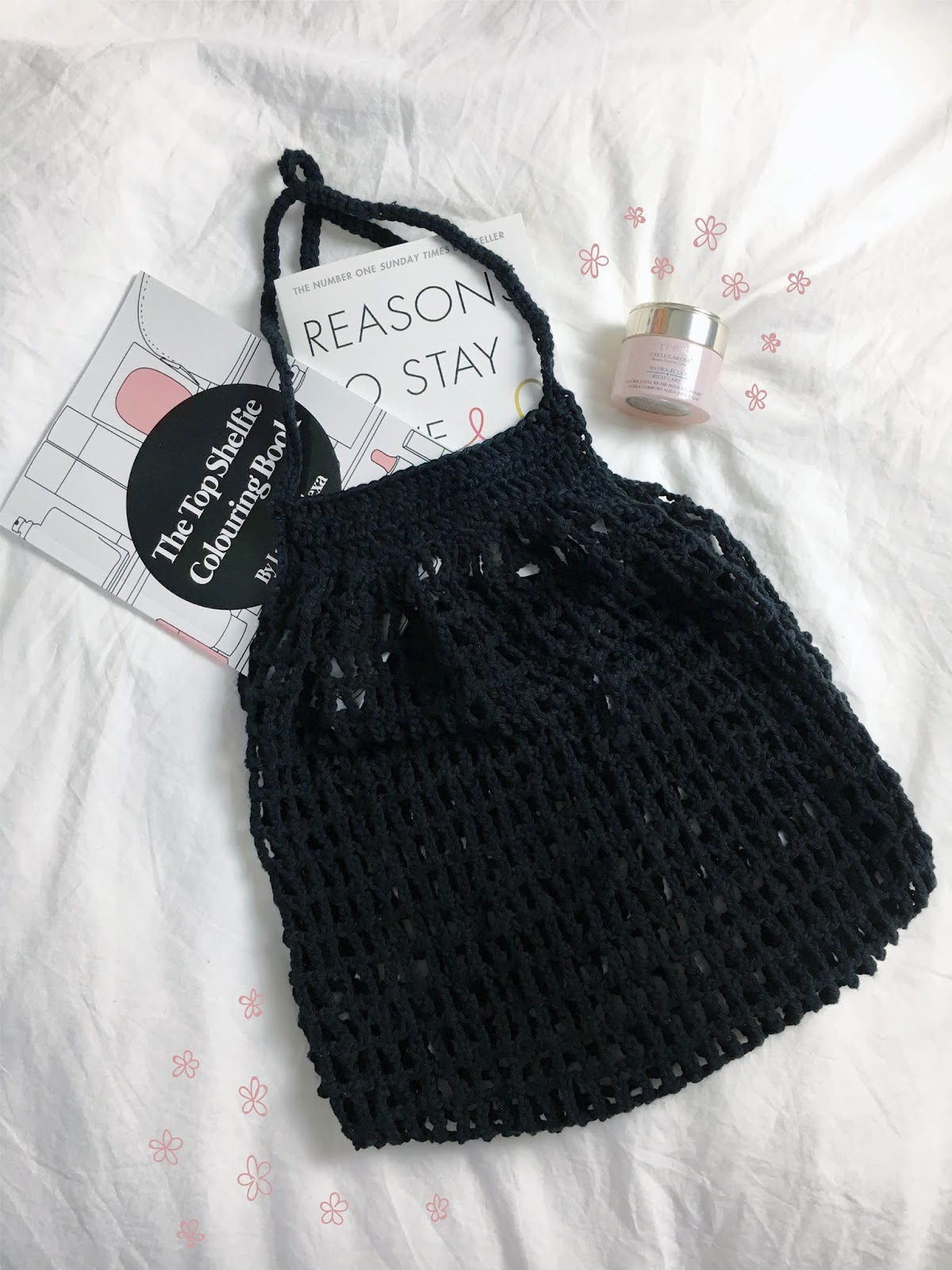 black mesh string hand crochet bag with top shelfie illustrated colouring book and matt haig book how to stay alive