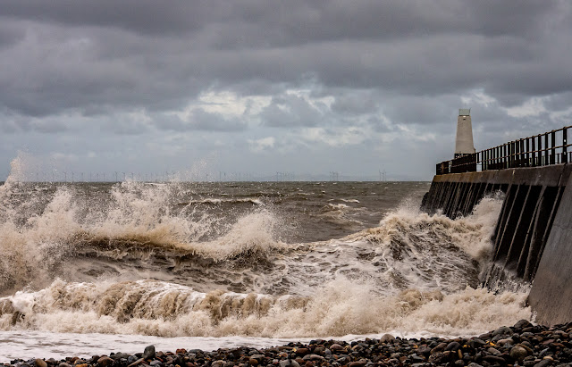 Photo of big waves whipped up by high winds on the shore at Maryport in Cumbria, UK