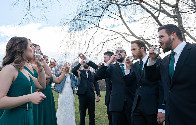 Bride and Groom and Bridal party having a drink of water Magnolia Farm Asheville Wedding Photography captured by Houghton Photography