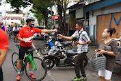 Ikatan Sport Sepeda Indonesia Sulut Bagikan Masker ke Masyarakat