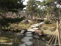 Rope 'tents' for winter protection along stone path - Kenroku-en Garden, Kanazawa, Japan