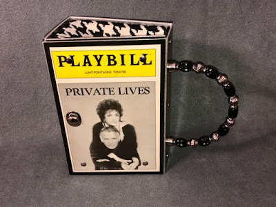 Photo of a purse with the playbill for the play Private Lives
