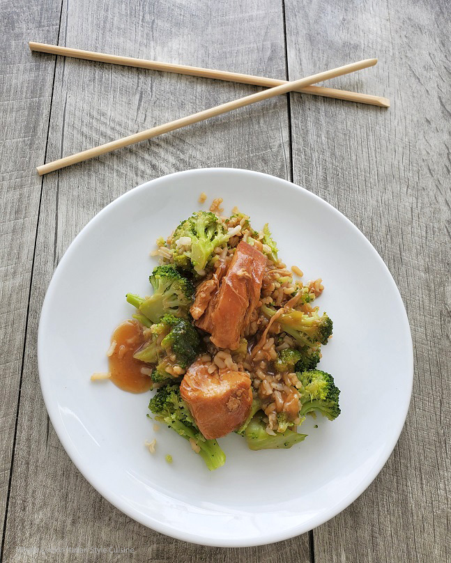 this is rice, broccoli and chicken asian style with chopsticks