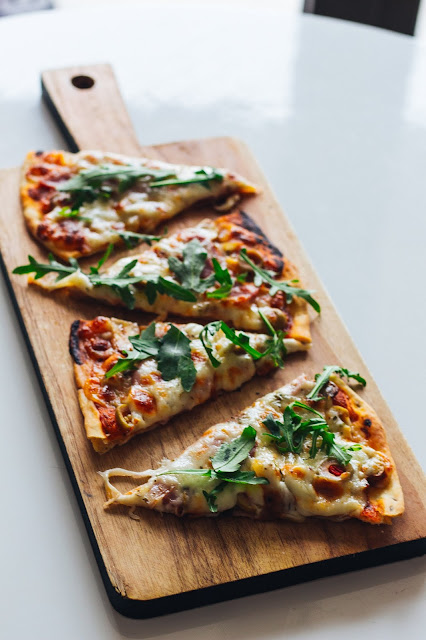 Pizza with Arugula on it