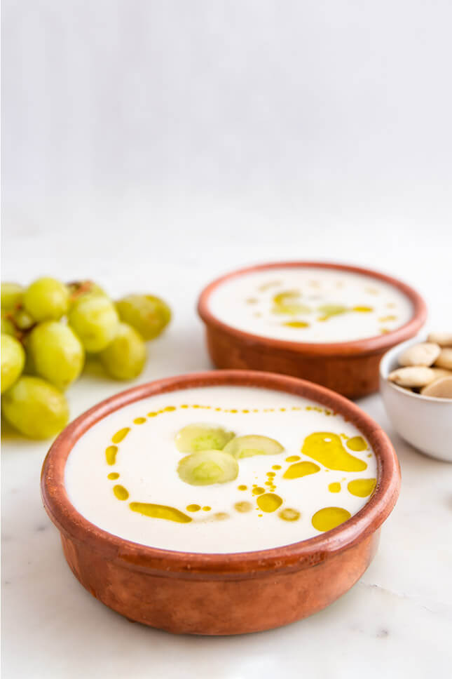 Photo of 2 Delicious And Very Creamy Ajoblanco (7 Ingredients) balls with grapes and olive oil on top