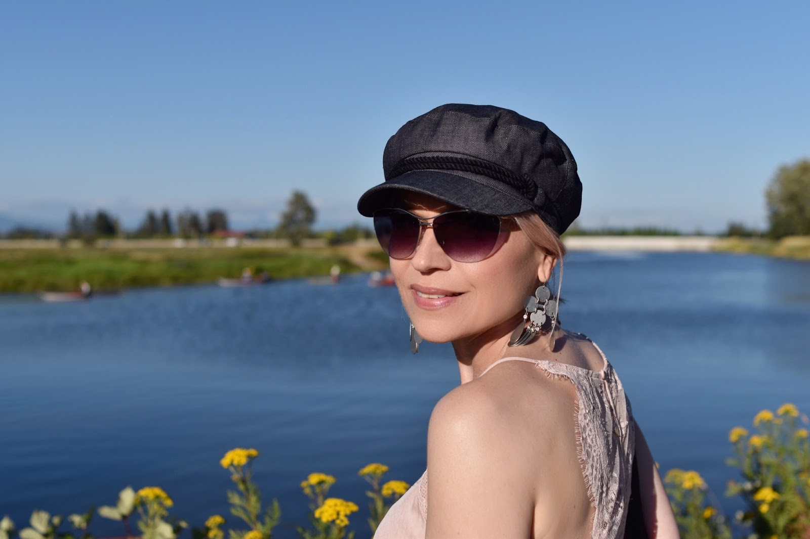 Monika Faulkner personal style inspiration - pink lace-trimmed camisole, wire-frame sunglasses, baker boy cap