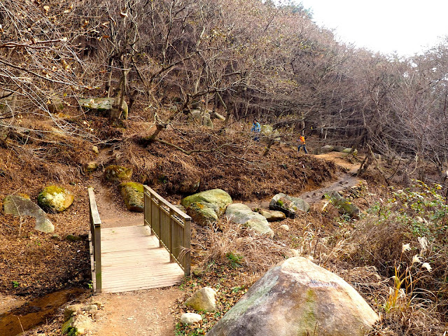 Small bridge crossing a stream on the hiking trail near Nammam Village on Geumjeongsan Mountain, Busan, South Korea