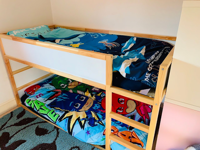An IKEA Kura mid sleeper bed with Dreamtex children's bedding on (a National Geographic sea creatures design on the top bunk and PJ Masks on the bottom bunk)