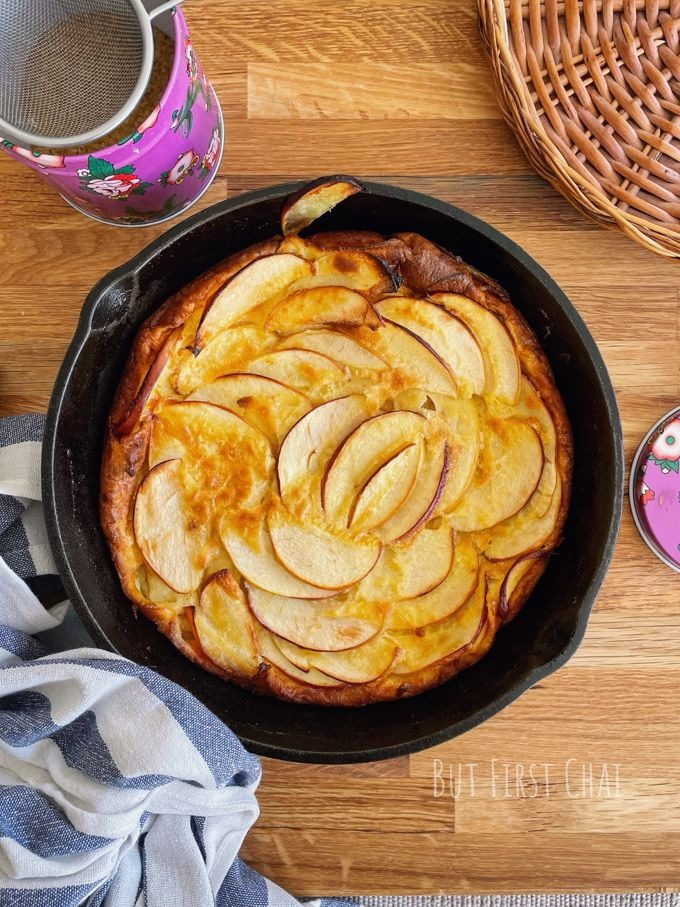 Dutch baby with apples in a cast-iron skillet