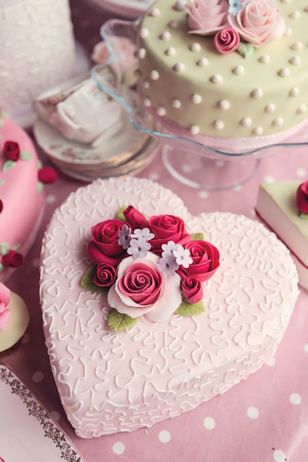 Large heart shaped cake with lots of sugar craft roses