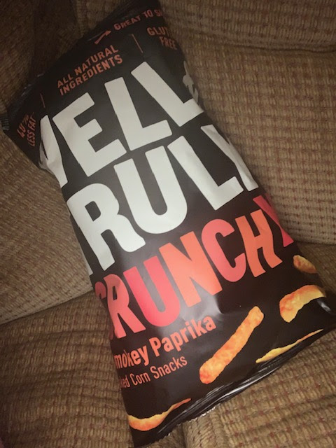 Bag of paprika crisps on the sofa
