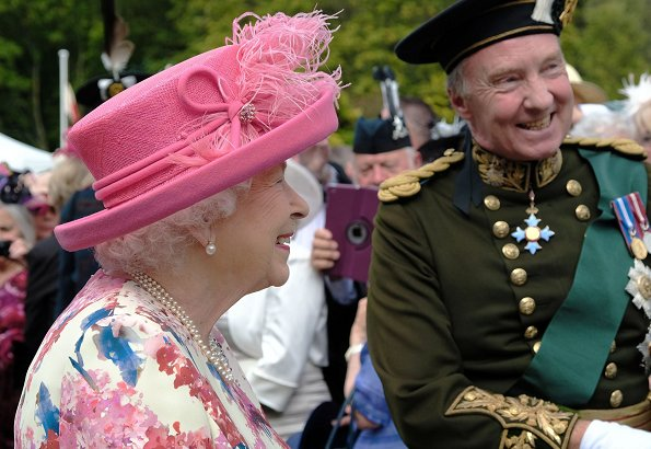 The Queen is hosting a Garden Party in the grounds of the Palace of Holyroodhouse. Scottish rugby player Doddie Weir.