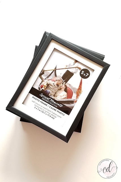 Dollar store picture frames to make a farmhouse style lantern.