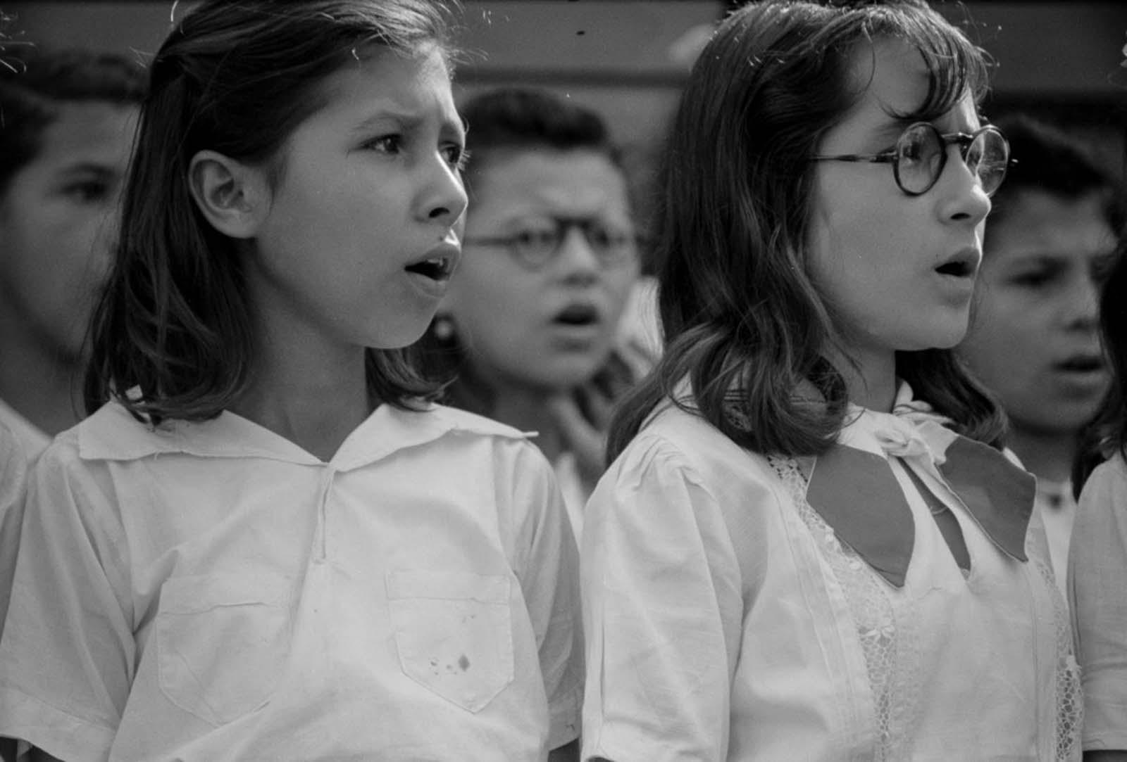 FMembers of a glee club sing during a party for FSA borrowers in Corozal.