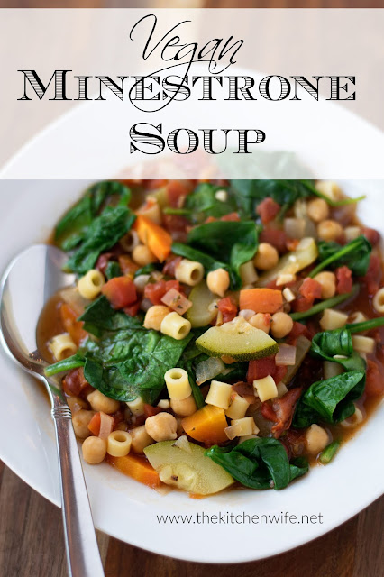A white bowl of the one pot vegan minestrone soup recipe with a spoon to the side and the title above.