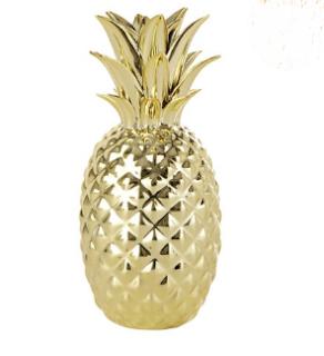 http://www.maisonsdumonde.com/FR/fr/produits/fiche/statuette-ananas-doree-h-23-cm-159977.htm