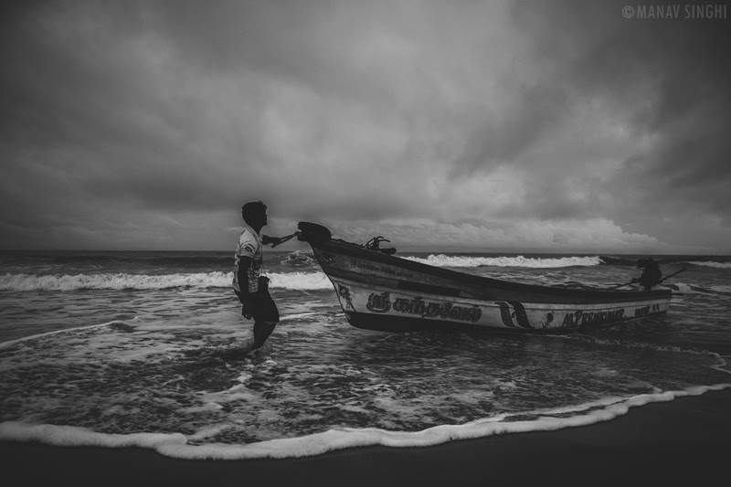 A Fisherman trying to control his boat at Fisherman Area near Le Pondy Beach Resort, Pondicherry- 30-Oct-2019