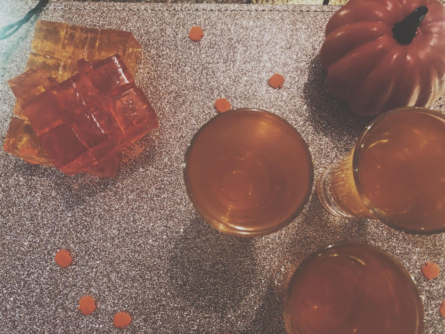 orange jelly in shot glasses ready to cool