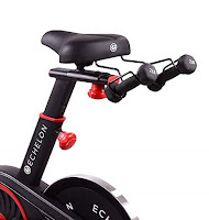 Echelon Smart Connect EX1 Spin Bike's comfort saddle with seat-mounted dumbbell holder, image