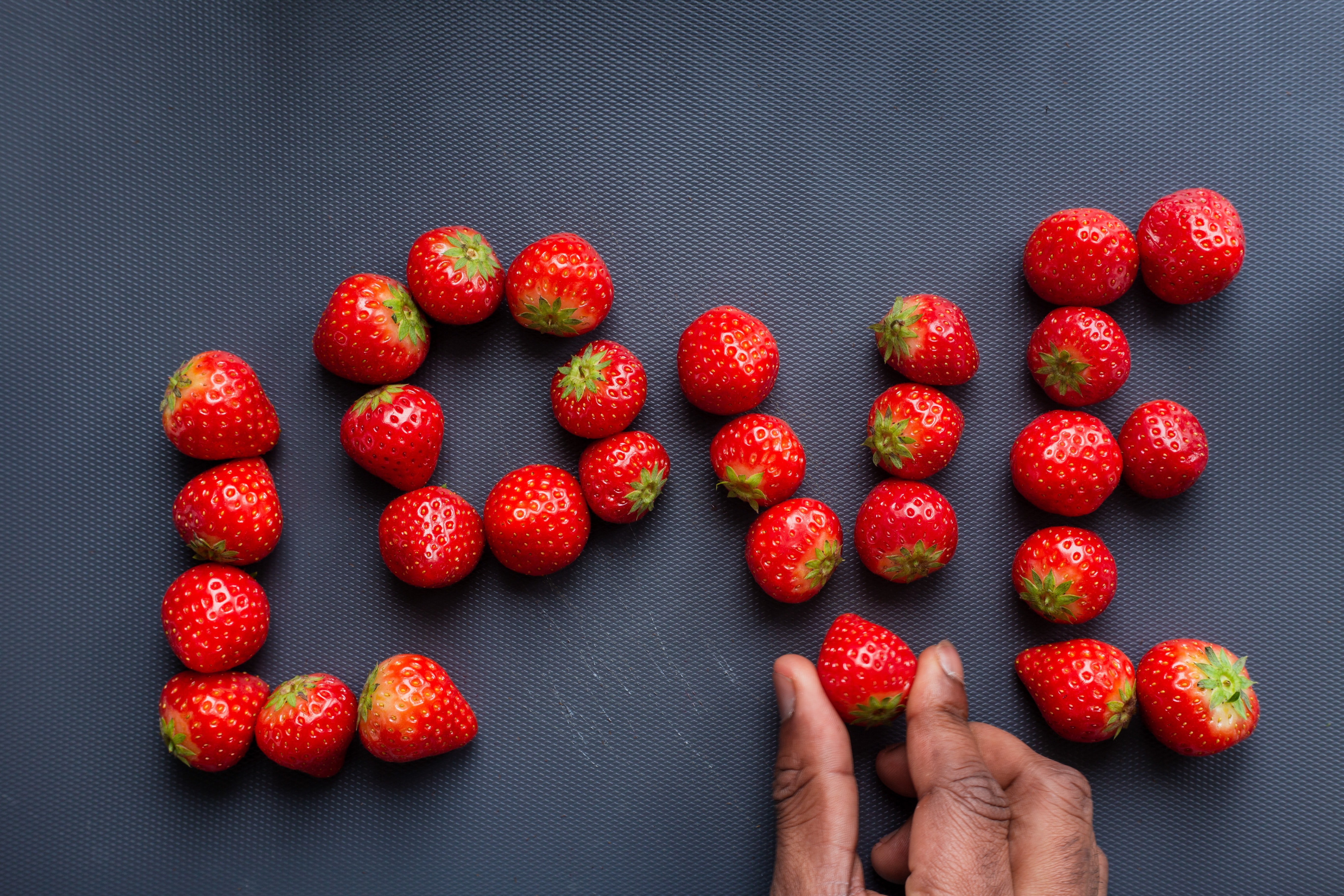Strawberries arranged into the word Love