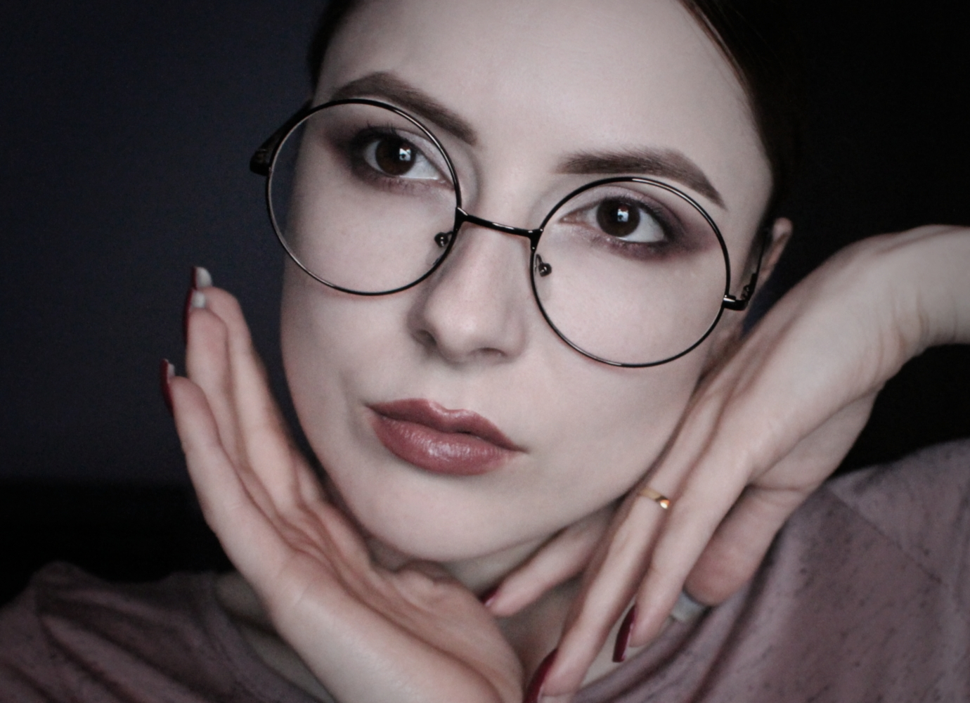 nerd girl in huge round glasses