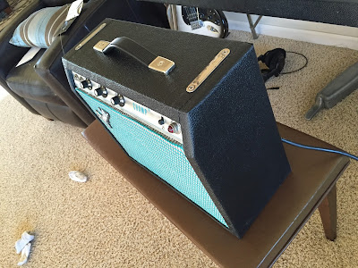 Beautifully restored Fender Champ amp side view