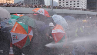 Hong Kong police use tear gas against protesters attempting to storm parliament