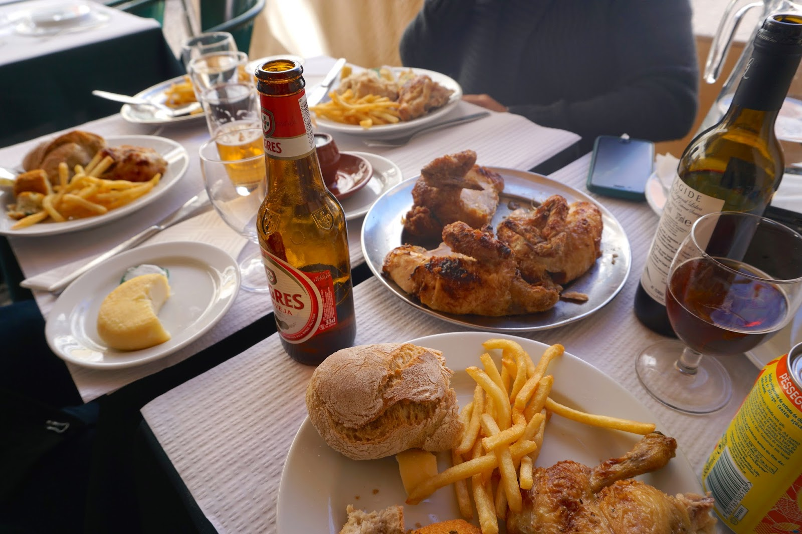 Eating portuguese chicken for lunch, with beers and wine