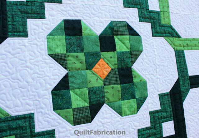 green four leaf clover quilt center