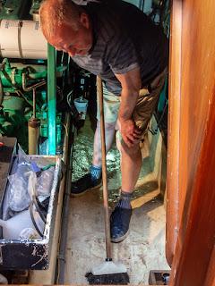 Photo of Phil scrubbing the bilges