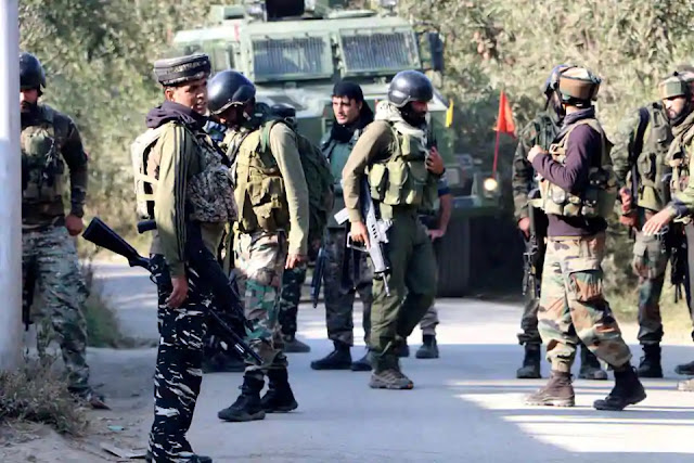 Security personnel near the encounter site in J&K's Shopian district on Wednesday
