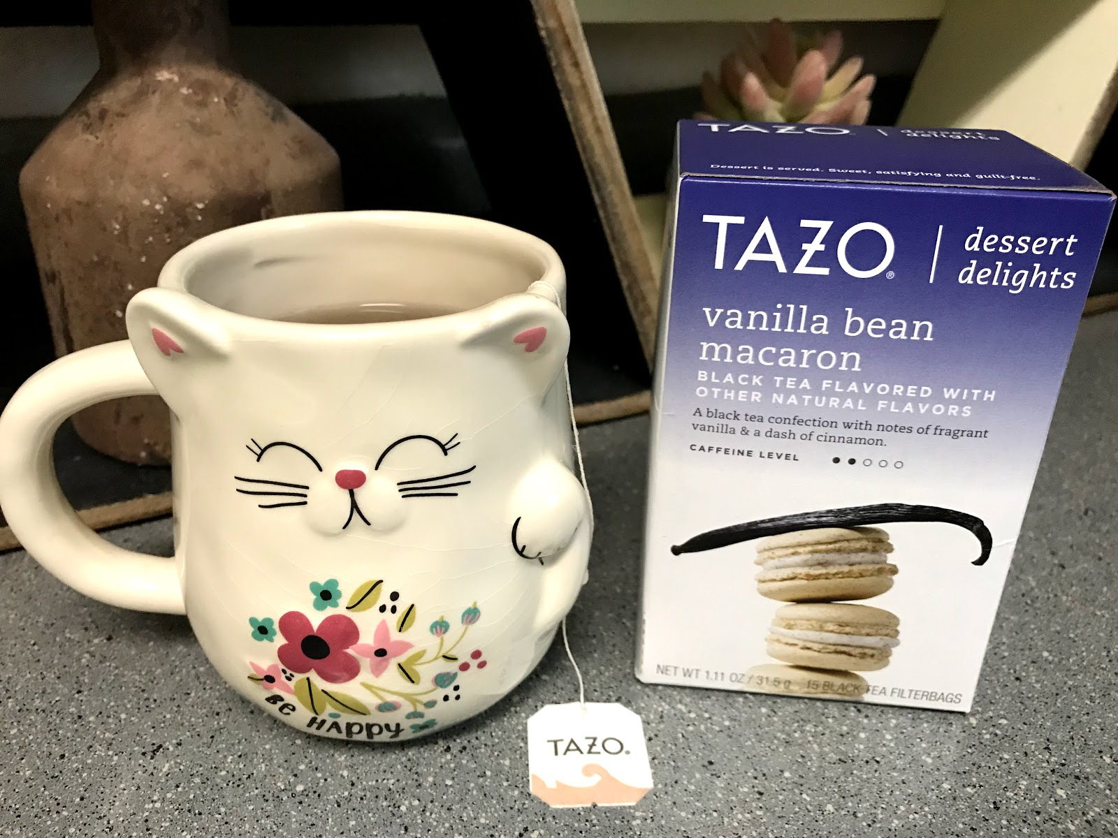 Image: Woman sharing one of her favorite bits to do is relax on the weekend with a big hot cup of Vanilla Bean Macaron dessert delights by Tazo. It is the best thing ever and it was a must add into my weekend bits and favorites.
