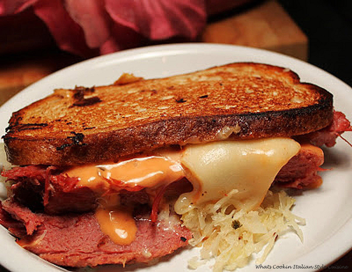Delicious rye bread with sauerkraut swiss cheese, thousand island dressing corned beef grilled