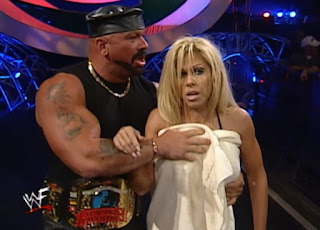 WWE / WWF Summerslam 2000 - Perry Saturn tries to cover Terri's nakedness