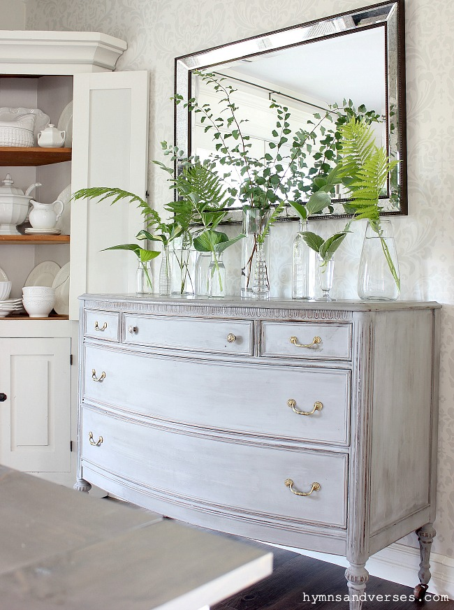 dresser with shade perennials in clear glass vases