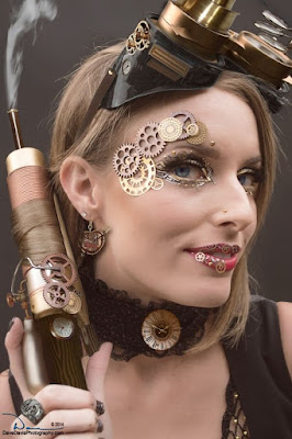 Steampunk makeup for halloween and cosplay. metal gears glued on eyes and lips in gold.