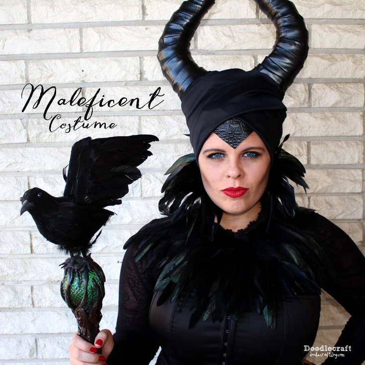 Maleficent Halloween costume or cosplay, black vinyl horns and headdress with scepter staff, diaval and winter cloak cape. Based off the Disney Maleficent live action movie.